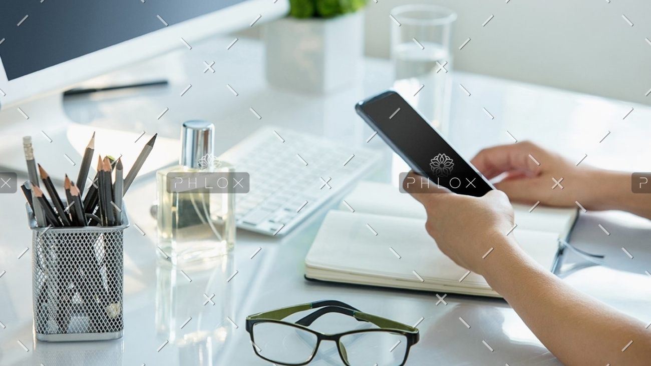 close-up-of-female-hands-using-smart-phone-while-PWQR3QP
